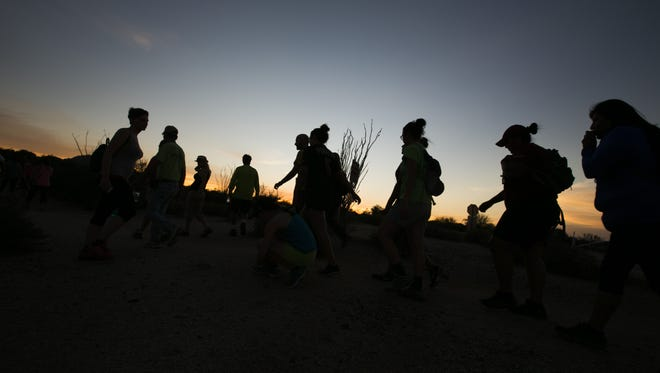 Hikers make their way toward a trail for the Full Moon Hike at McDowell Mountain Regional Park in Fountain Hills, AZ on July 2, 2015.