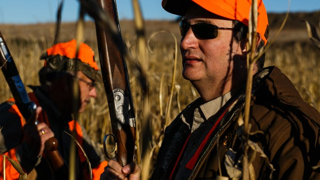 Republican presidential candidate Ted Cruz walks through the fields during the Col. Bud Day Pheasant Hunt at The Hole N the Wall Lodge on Saturday, October 31, 2015 in Akron, Iowa.