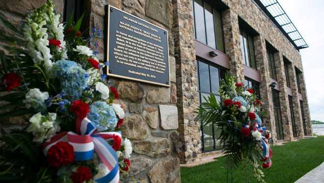 A plaque honoring the late Beau Biden on the National Guard Headquarters named after him is shown on Feb. 15. The Guard recently announced a major energy efficiency project in its buildings.