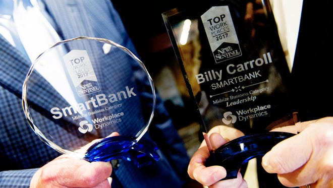 Representatives from SmartBank hold their awards during the 2017 Top Workplaces event.