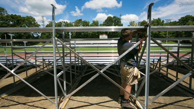 Kyler Scheerer with First State Fabrication installs temporary bleachers at Baynard Stadium on Aug. 4, 2016. The south side bleachers were condemned after a structural engineering assessment. A potential deal that would allow Salesianum School to renovate and operate the stadium appears to be moving forward again.