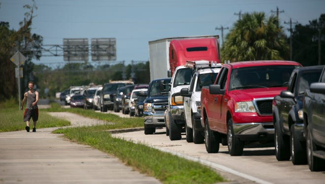Drivers waited for nearly two hours to get gas at Love's on Bayshore Road in North Fort Myers on Wednesday. Most southwest Florida gas stations  had similar lines.