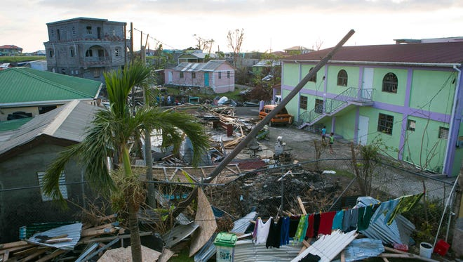 The town of Portsmouth, Dominica, is still without power since a Category 5 hurricane came through the island on Sept. 18.
