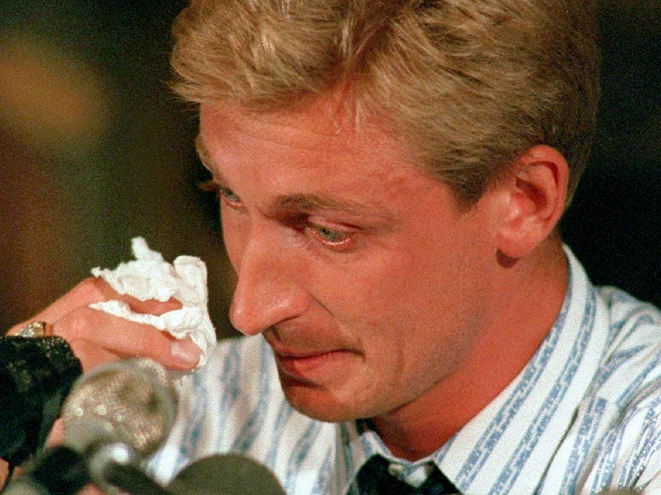 Gretzky fought back tears in his farewell news conference in Edmonton.