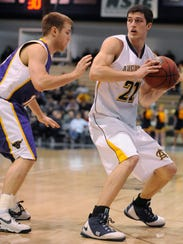 Augustana's Cody Schilling looks for a way past Minnesota