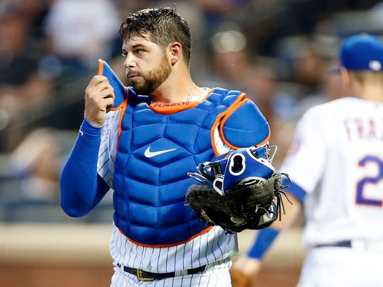 New York Mets catcher Kevin Plawecki (26) reacts after
