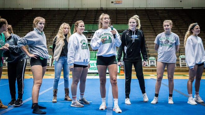 The New Castle volleyball team is introduced at the New Castle Fieldhouse during a pep rally Thursday evening.