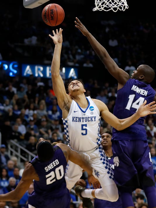 Kentucky forward Kevin Knox (5) shoots against Kansas State's Xavier Sneed (20) and Makol Mawien (14) during the second half of a regional semifinal NCAA college basketball tournament game, Thursday, March 22, 2018, in Atlanta. (AP Photo/David Goldman)