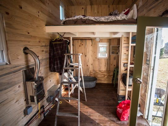 The interior of a tiny home built by two Earlham College