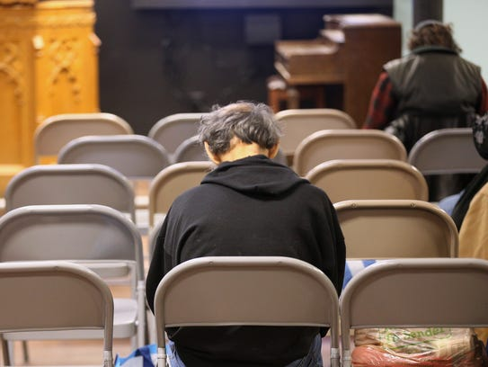 A man finds comfort at the Open Door Mission. The facility