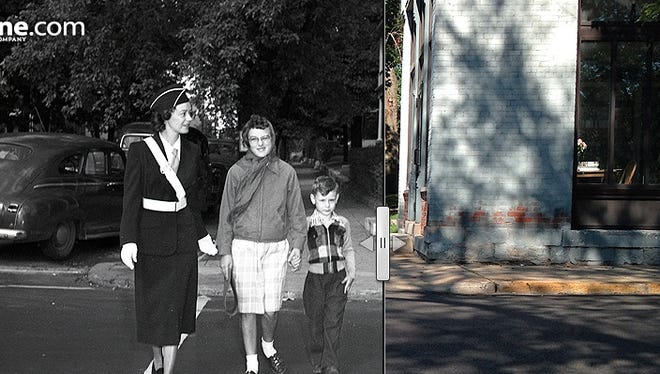 Melba R. May, one of Lafayette's 11 new policewomen school patrol guards, assists children across the intersection of Ninth and Brown streets on Aug. 27, 1952.