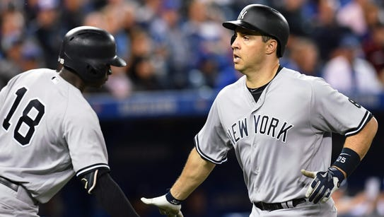 New York Yankees' Mark Teixeira is congratulated at