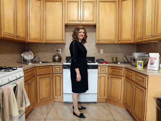 Chany Rosengarten, 30, in her kitchen while making