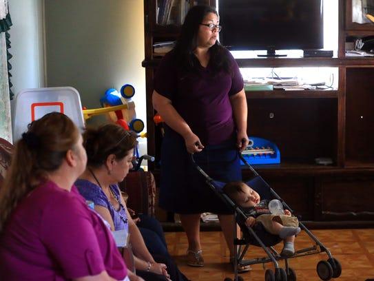 Rosario Teran (back) talks about living near the border