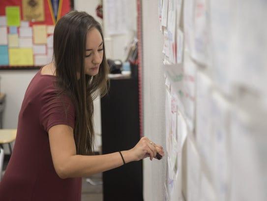 Angela Velazquez preps her classroom before the start