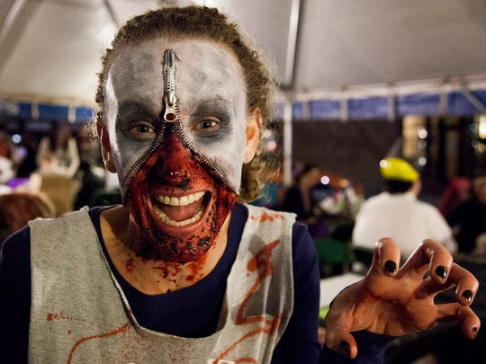 Courtney Schinner, from Fort Collins, stalks the makeup tent Saturday evening during the Old Town Halloween Zombie Fest's zombie crawl.