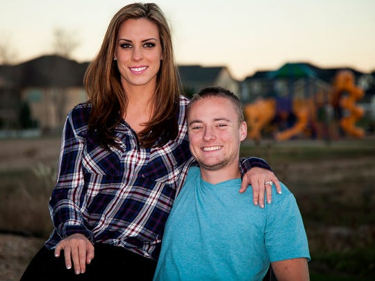 Rachel and Jason Hallett outside their home in Windsor, Colo., Sunday Nov. 8, 2015. Jason Hallett, a former Marine, suffered the traumatic amputation of both legs and his right arm, in addition to extensive injuries to his left hand when he stepped on an improvised explosive device (IED) in Sangin, Afghanistan on October 23, 2010.