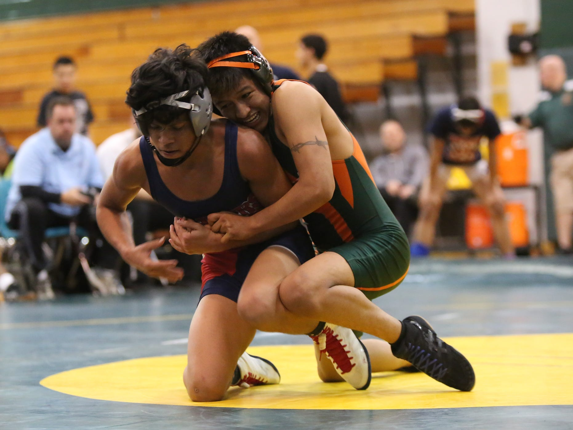 Yonkers' DJ Carrera, left, wrestles East Ramapo's Luis Lema-Lema in a 120-pound match during a quad meet in the Section 1 dual meet championships at Ramapo High School in Spring Valley on Dec. 2, 2015. East Ramapo defeated Yonkers 53-29 and advanced to the quarterfinals.