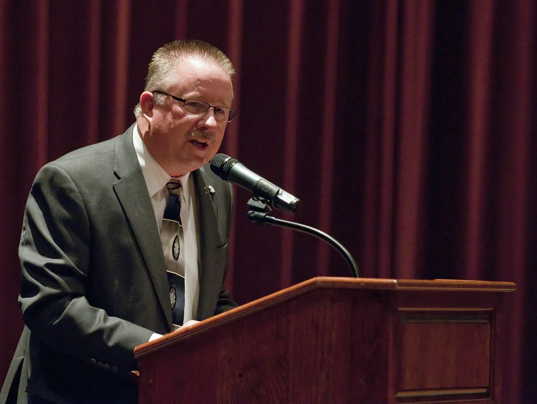 Indiana High School Athletic Association Commissioner Bobby Cox spoke to a crowd during a town hall meeting April 17, 2012, at Plainfield High School.