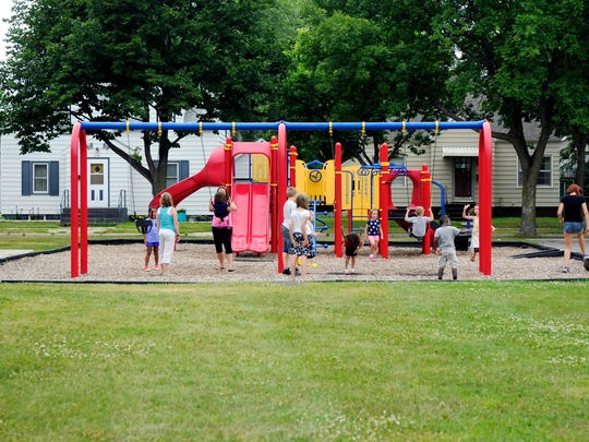 Children play Thursday, July 7, at Seberger Park in St. Cloud. The park also has a wading pool, tennis and basketball courts, and a shelter with a climbing wall.