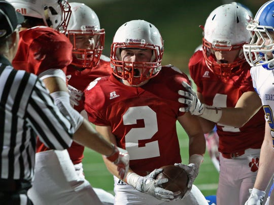 Beechwood RB Aiden Justice celebrates his TD with teammates in the game against Kentucky Country Day in the KHSAA Football Playoffs at Beechwood High School.