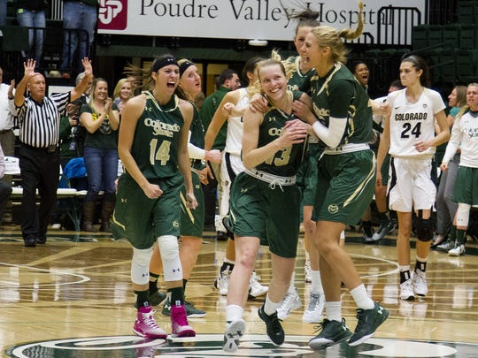 CSU players celebrate a game-winning shot by Ellen Nystrom (13) to beat CU in 2016.