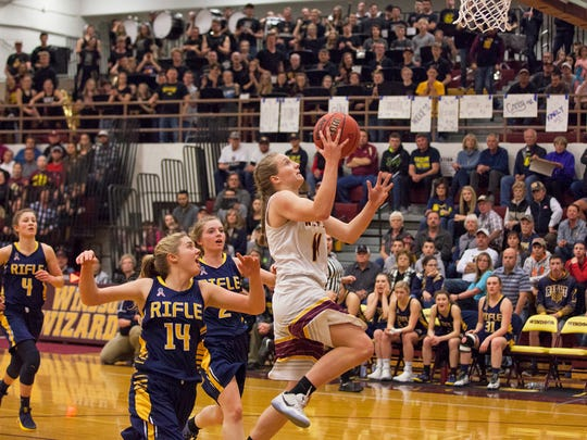 Windsor's Madi Denzel (14) goes up for an open basket against Rifle in front of a packed home court audience in the Great Eight. The Wizards play in the Final Four on Thursday.