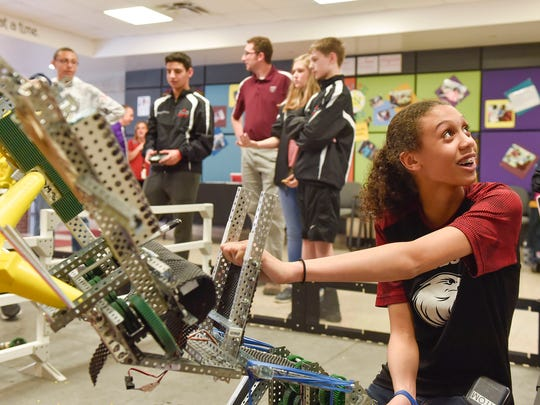Members of the Grant Middle School robotics team meet with visitors during an open house last Tuesday. The team reached the semifinals of the VEX Worlds competition in Louisville, Kentucky.