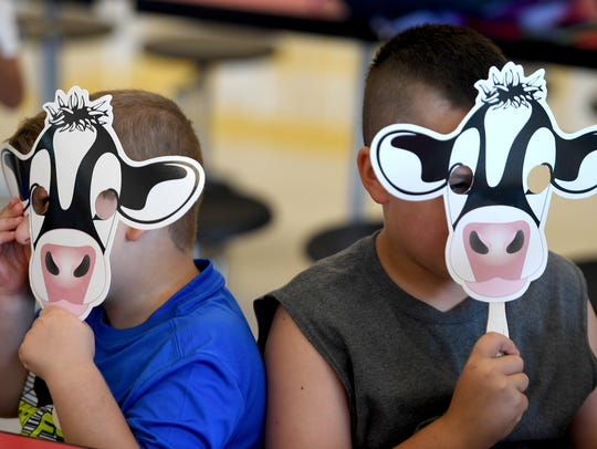 Peter Turner and Bentley Miller show off their cow