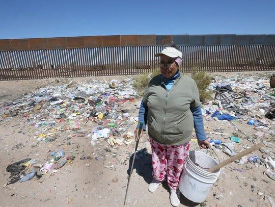 Doña Cuca Aguilera picks through a small trash dump