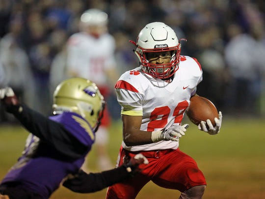 Beechwood running back James Davis scoots avoids a