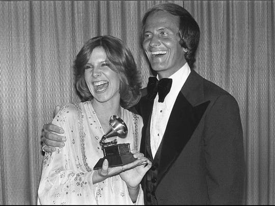 Debby Boone is congratulated by her father, Pat Boone,