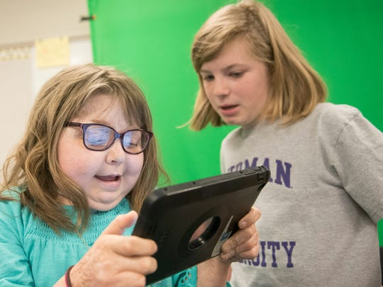 Reese Burdette, left, and Nina McDowell are in a video production class on Thursday, March 15, 2018. Reese  returned to her Mercersburg Elementary School class on March 2 after a 100-day quarantine after a kidney transplant. She survived a house in 2014 and has had medical issues along the way.