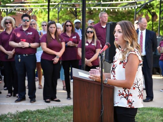 In this file photo, Jana Schmader, executive director of Downtown Wichita Falls Development, speaks in June 2018, during an announcement that Texoma Community Credit Union will open a branch office in the historic City National Building at 8th Street and Scott Avenue.