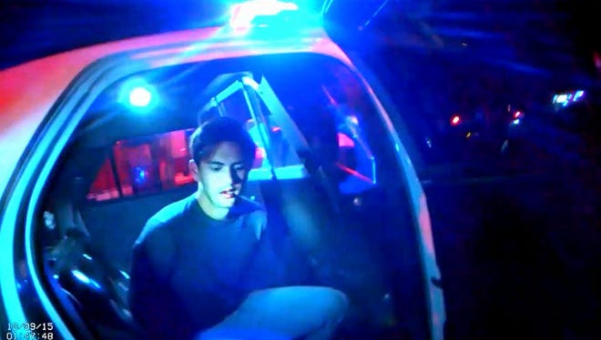 Steven Jones in a patrol car shortly after his arrest by Northern Arizona University police.