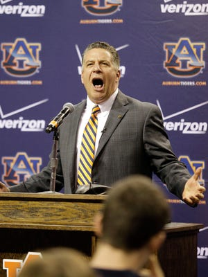 Auburn Tigers head basketball coach Bruce Pearl addresses the media and fans during his introductory press conference in the Auburn Arena on Tuesday.