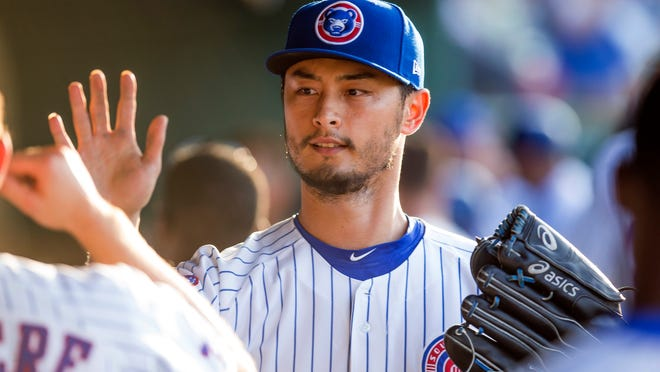Chicago Cubs' Yu Darvish high fives players during the West Michigan Whitecaps at South Bend Cubs baseball game Monday, June 25, 2018 at Four Winds Field in South Bend, Indiana. Darvish was on a one-game rehab assignment with the Class A affiliate of the major league team. (Michael Caterina/South Bend Tribune via AP)