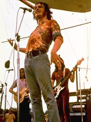 Joe Cocker performs during the Woodstock Music Festival