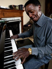 "Nashville native Bobby Hebb, who has recently moved back, plays on the piano at his home. The prolific songwriter and R&B star was among the artists featured in ""Night Train to Nashville."""