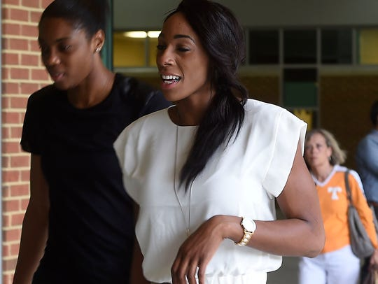 Glory Johnson arrives by bus and enters the VIP entrance