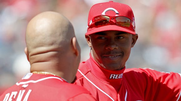 Cincinnati Reds starting pitcher Raisel Iglesias (26) talks to catcher Brayan Pena during the game against the St. Louis Cardinals Saturday.