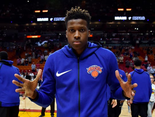 New York Knicks guard Frank Ntilikina (11) reacts prior