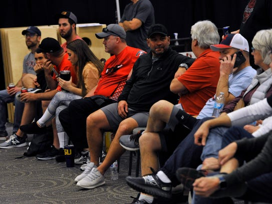 Spectators and players watch during the Texas Cornhole League's Signature Series tournament at the Abilene Convention Center Saturday.