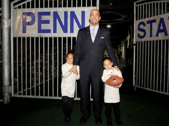 James Franklin poses at Beaver Stadium with his daughters, Addison, right, and Shola, left, after he was introduced as the school's new football coach on Jan. 11.