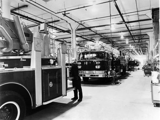 A line of aerial ladder trucks and pumpers go through final assembly in American LaFrance's new manufacturing facility in Elmira. After final assembly, the vehicles move to another area for lettering and striping.
