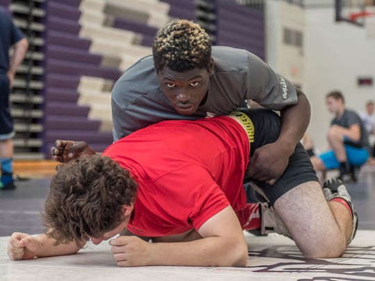 Lakeview's Stephan Moody works on some of his moves at Rob Waller's AllAmerican Wrestling Camps at Lakeview High School on Wednesday.