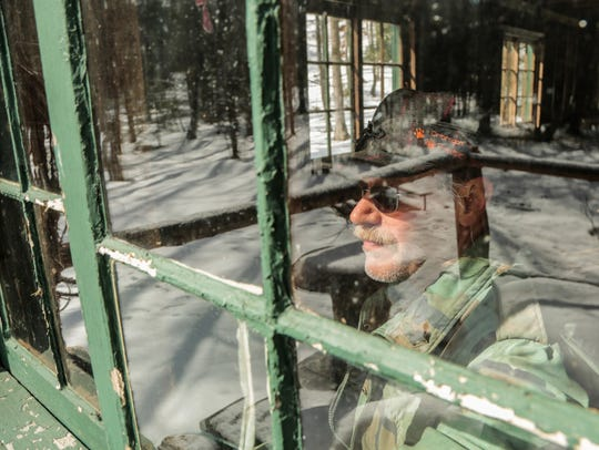 Armas Ojaniemi, 60, of Bruce Crossing looks out the