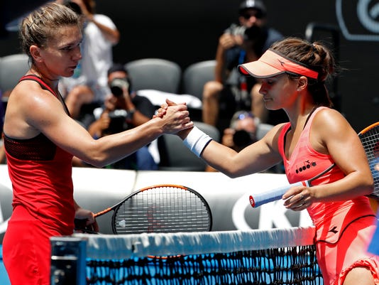 Romania's Simona Halep, left, shakes hands with United States' Lauren Davis as she won their third round match at the Australian Open tennis championships in Melbourne, Australia, Saturday, Jan. 20, 2018. (AP Photo/Ng Han Guan)