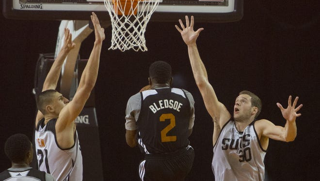 Suns' Alex Len (21) and Jon Leuer (30) go up to block a lay-up from Eric Bledsoe in the first half during a scrimmage at the Arizona Veterans Memorial Coliseum in Phoenix, AZ on October 3, 2015.