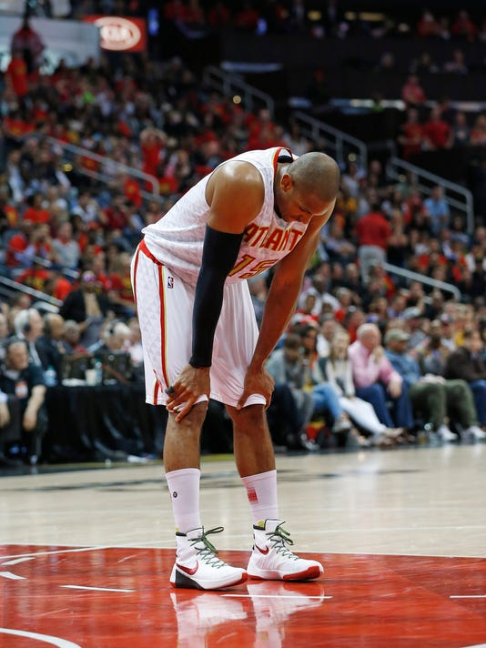 Atlanta Hawks center Al Horford (15) pauses in the second half of Game 3 of the second-round NBA basketball playoff series against the Cleveland Cavaliers, Friday, May 6, 2016, in Atlanta. Cleveland won 121-108 and leads the best-of-seven series 3-0. (AP Photo/John Bazemore)